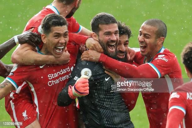 Liverpool goalkeeper Alisson Becker celebrates with teammates after scoring their 2nd goal during the Premier League match between West Bromwich...