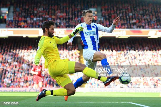 Liverpool goalkeeper Alisson Becker challenges Solly March of Brighton during the Premier League match between Liverpool and Brighton Hove Albion at...