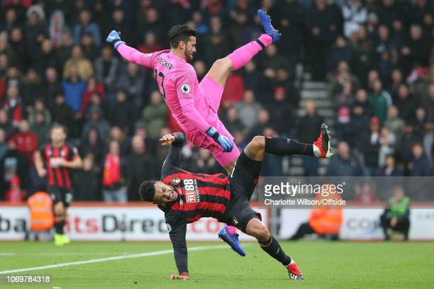 Liverpool goalkeeper Alisson Becker collides with Joshua King of Bournemouth during the Premier League match between AFC Bournemouth and Liverpool FC...