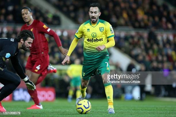 Liverpool goalkeeper Alisson Becker comes out to knock the ball from the feet of Lukas Rupp of Norwich during the Premier League match between...
