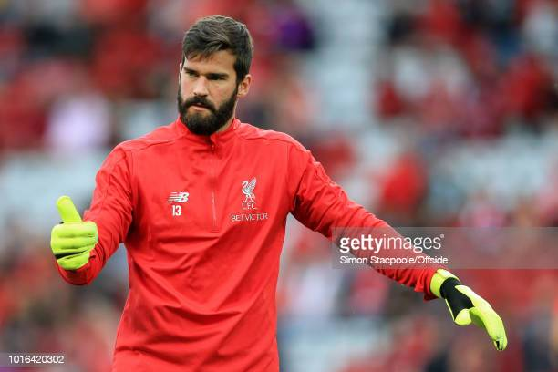 Liverpool goalkeeper Alisson Becker gives the thumbsup ahead of the preseason friendly match between Liverpool and Torino at Anfield on August 7 2018...