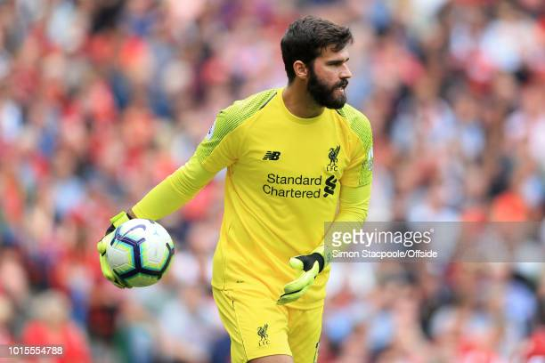 Liverpool goalkeeper Alisson Becker in action during the Premier League match between Liverpool and West Ham United at Anfield on August 12 2018 in...