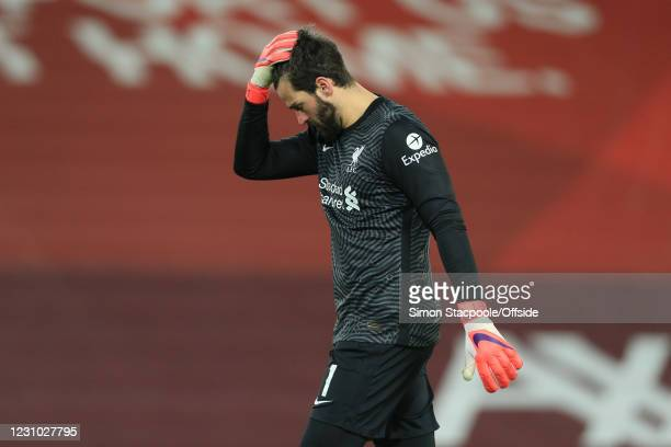 Liverpool goalkeeper Alisson Becker looks dejected after their 4-1 defeat during the Premier League match between Liverpool and Manchester City at...