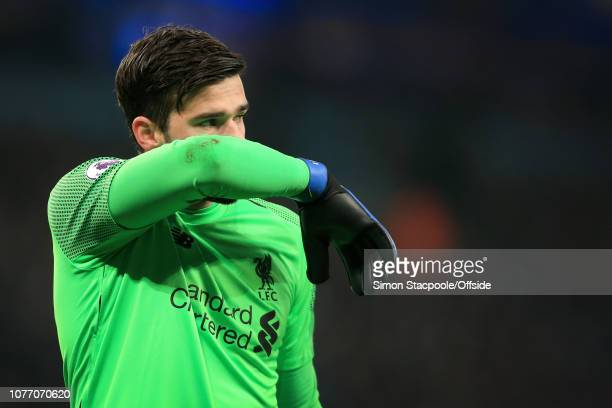 Liverpool goalkeeper Alisson Becker looks dejected during the Premier League match between Manchester City and Liverpool at the Etihad Stadium on...