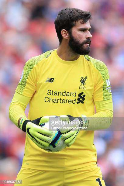 Liverpool goalkeeper Alisson Becker looks on during the Premier League match between Liverpool and West Ham United at Anfield on August 12 2018 in...