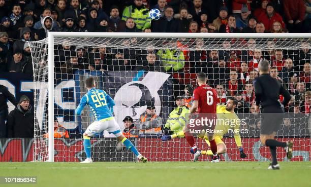 Liverpool goalkeeper Alisson Becker makes a save from Napoli's Arkadiusz Milik Liverpool v Napoli UEFA Champions League Group C Anfield