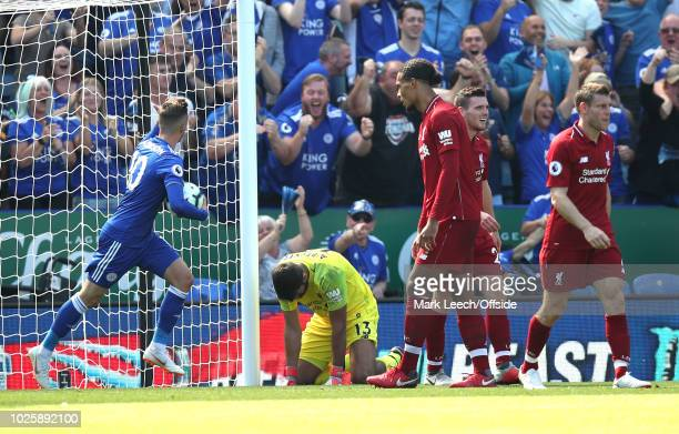 Liverpool goalkeeper Alisson Becker on his knees after making an error that led to the Leicester goal during the Premier League match between...
