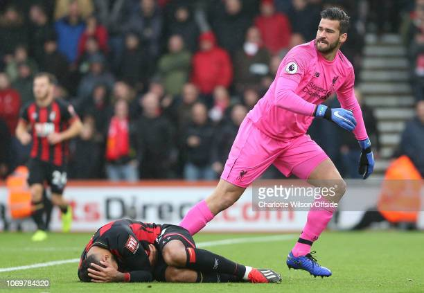 Liverpool goalkeeper Alisson Becker runs back to his goal line as Joshua King of Bournemouth lies injured after a collision between the two during...