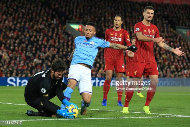 Liverpool goalkeeper Alisson Becker saves at the feet of Gabriel Jesus of Man City during the Premier League match between Liverpool FC and...