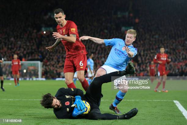 Liverpool goalkeeper Alisson Becker saves at the feet of Kevin De Bruyne of Man City as Dejan Lovren of Liverpool looks on during the Premier League...