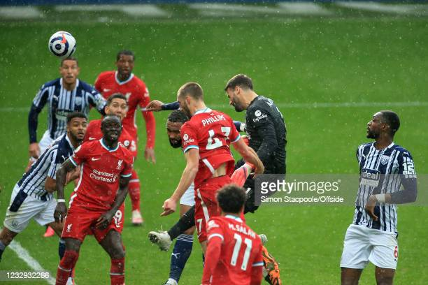 Liverpool goalkeeper Alisson Becker scores a last minute goal to give Liverpool a victory over West Brom during the Premier League match between West...