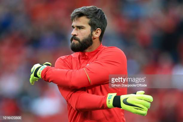 Liverpool goalkeeper Alisson Becker warms up ahead of the preseason friendly match between Liverpool and Torino at Anfield on August 7 2018 in...