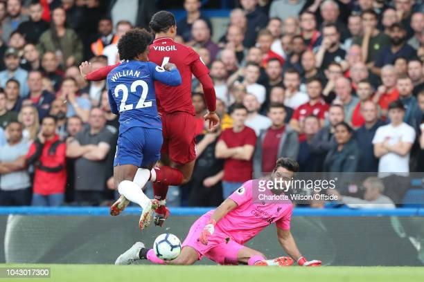 Liverpool goalkeeper Alisson spreads to save the shot of Willian of Chelsea during the Premier League match between Chelsea FC and Liverpool FC at...