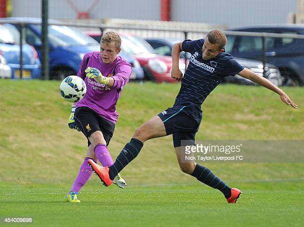 Liverpool goalkeeper Andrew Firth and Charles Vernam of Derby County in action during the Barclays Premier League Under 18 fixture between Liverpool...