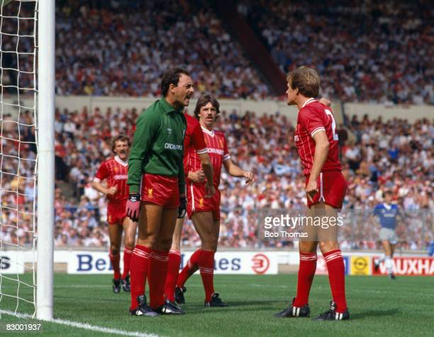 Liverpool goalkeeper Bruce Grobbelaar argues with his teammate Phil Neal during the FA Charity Shield match against Everton at Wembley Stadium August...