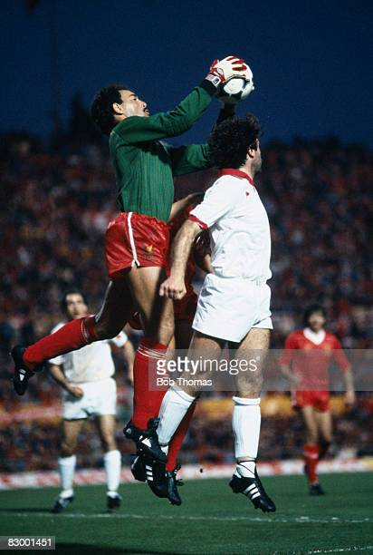 Liverpool goalkeeper Bruce Grobbelaar catches the ball under pressure from Roma's Pruzzo during the European Cup Final at the Olympic Stadium in...