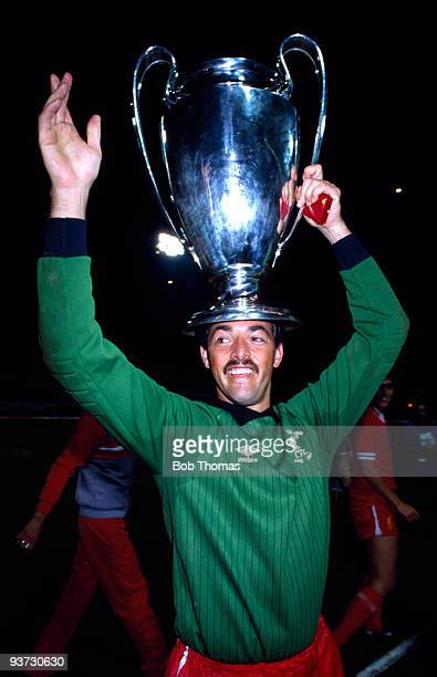 Liverpool goalkeeper Bruce Grobbelaar celebrates with the European Cup after Liverpool's win against Roma 42 on penalties in the European Cup Final...