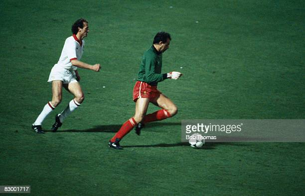 Liverpool goalkeeper Bruce Grobbelaar dribbles the ball outside his penalty area chased by Roma's Paolo Falcao during the European Cup Final at the...