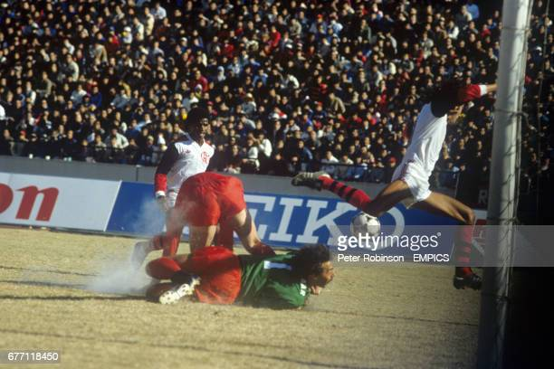 Liverpool goalkeeper Bruce Grobbelaar fails to stock a rebound shot from Flamengo's Adilio from going in to make the score 20 Also pictured is...