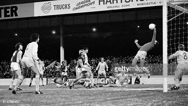 Liverpool goalkeeper Bruce Grobbelaar makes a spectacular one-handed save during their First Division match against Aston Villa at Villa Park in...