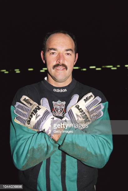 Liverpool goalkeeper Bruce Grobbelaar poses after a match with his Mitre goalkeeping gloves circa 1992 in Liverpool England