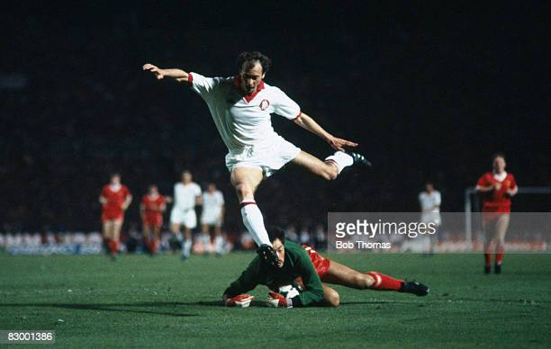 Liverpool goalkeeper Bruce Grobbelaar saves at the feet of AS Roma's Paolo Falcao during the European Cup Final at the Olympic Stadium in Rome May...