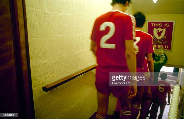 Liverpool goalkeeper Bruce Grobbelaar touches the famous 'This is Anfield' sign as the players descend down the steps in the players tunnel to enter...