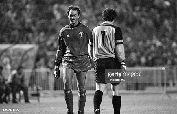 Liverpool goalkeeper Bruce Grobbelaar walks past AS Roma goalkeeper Franco Tancredi as they take their turn to face penalties to decide the game...
