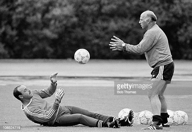 Liverpool goalkeeper Bruce Grobbelaar working with coach Ronnie Moran during a training session held in Munich on 22nd July 1987 during Liverpool's...