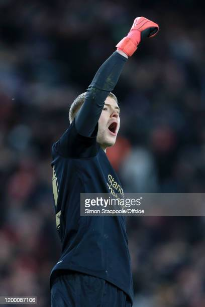 Liverpool goalkeeper Caoimhin Kelleher celebrates victory after the FA Cup Fourth Round Replay match between Liverpool and Shrewsbury Town at Anfield...