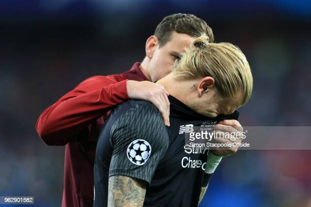 Liverpool goalkeeper Danny Ward consoles dejected teammate Liverpool goalkeeper Loris Karius after the UEFA Champions League Final match between Real...