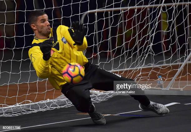 Liverpool goalkeeper David James makes the winning save during the match between the Liverpool Legend and the Manchester United Legends at Titanium...