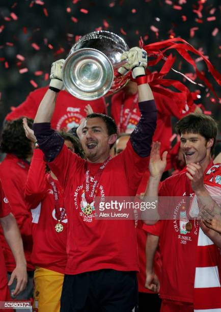 Liverpool goalkeeper Jerzy Dudek of Poland lifts the European Cup after Liverpool won the European Champions League final between Liverpool and AC...