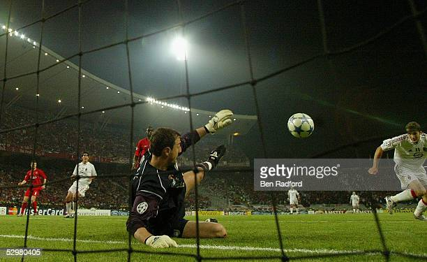 Liverpool goalkeeper Jerzy Dudek of Poland saves a shot from AC Milan forward Andriy Shevchenko of Ukraine during the European Champions League final...