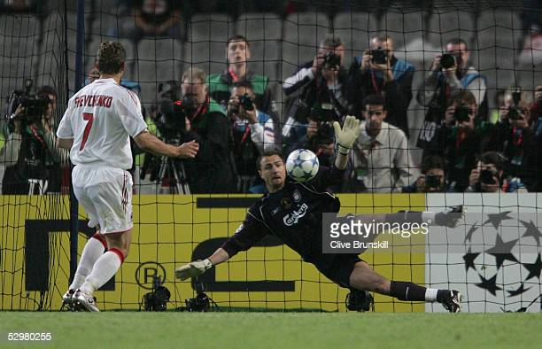 Liverpool goalkeeper Jerzy Dudek of Poland saves the decisive penalty from AC Milan forward Andriy Shevchenko of Ukraine during a penalty shoot out...