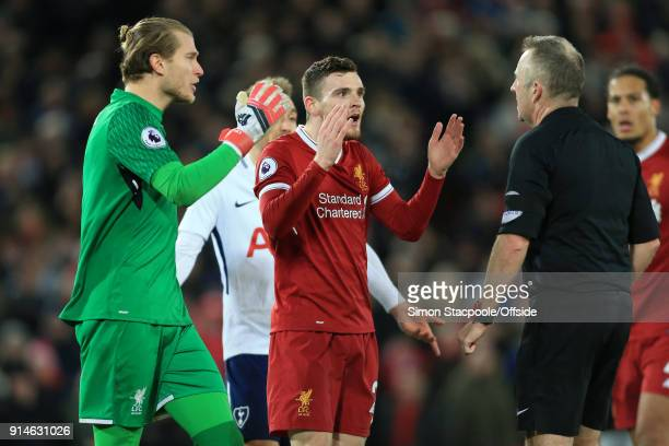 Liverpool goalkeeper Loris Karius and Andrew Robertson of Liverpool express their shock and surprise as referee Jon Moss awards a late penalty during...