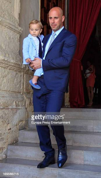 Liverpool Goalkeeper Pepe Reina and his son Luca Reina attend the Christening of their fourth son Thiago Reina on May 26 2013 in Cordoba Spain