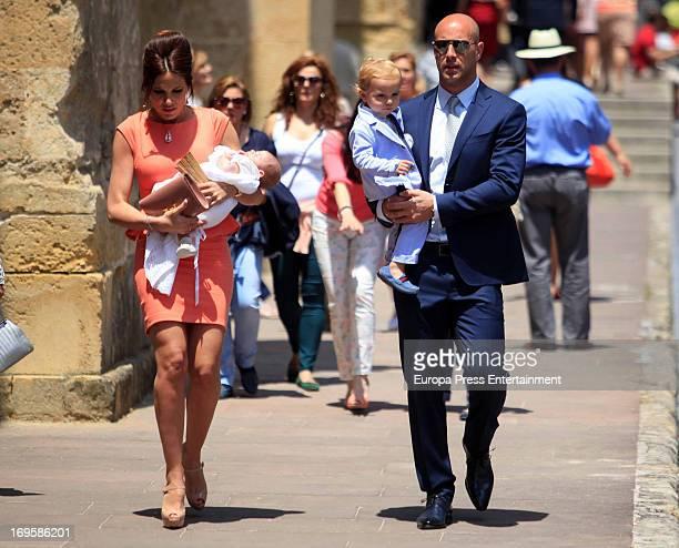 Liverpool Goalkeeper Pepe Reina his wife Yolanda Ruiz and their son Luca Reina attend the Christening of their fourth son Thiago Reina on May 26 2013...