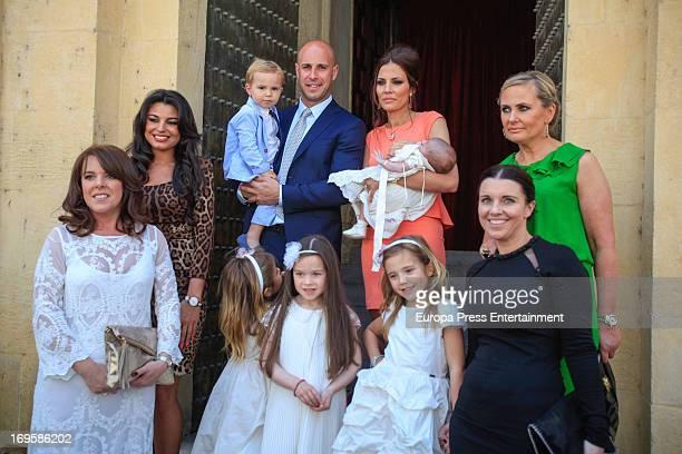 Liverpool Goalkeeper Pepe Reina his wife Yolanda Ruiz their son Luca Reina and their daughters Alma Reina below and Grecia Reina attend the...