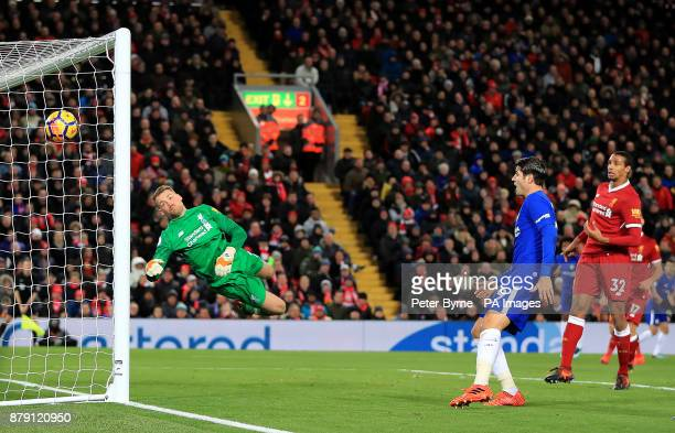 Liverpool goalkeeper Simon Mignolet dives in vain as Chelsea's Willian scores his side's first goal during the Premier League match at Anfield...