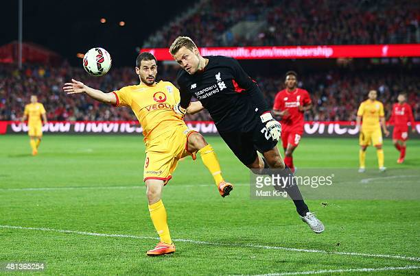 Liverpool goalkeeper Simon Mignolet is challenged by Sergio Cirio of United during the international friendly match between Adelaide United and...