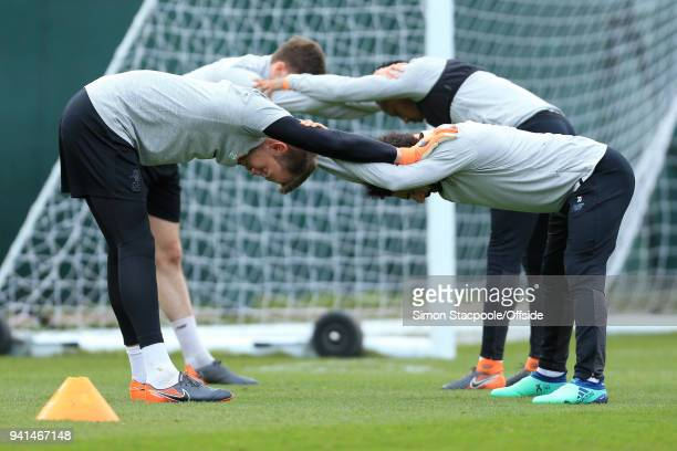 Liverpool goalkeeper Simon Mignolet stretches with teammate Mohamed Salah of Liverpool during a training session prior to their UEFA Champions League...