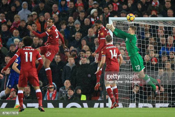 Liverpool goalkeeper Simon Mignolet tries to punch the ball clear during the Premier League match at Anfield Liverpool