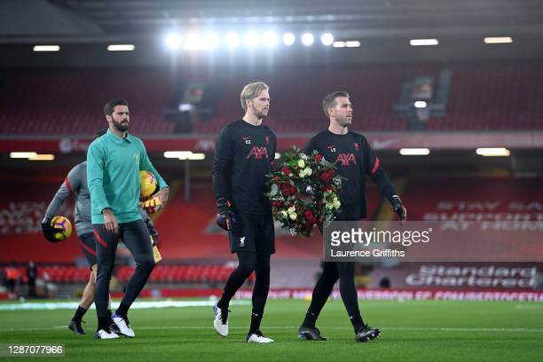 Liverpool goalkeepers, Alisson Becker , Adrian and Caoimhin Kelleher of Liverpool lay a wreath of flowers behind the goal in memory of former...