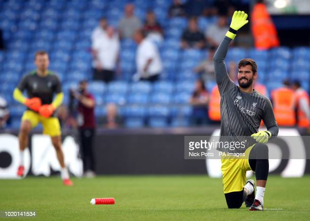 Liverpool goalkeepers Alisson Becker and Simon Mignolet warm up before the Premier League match at Selhurst Park London