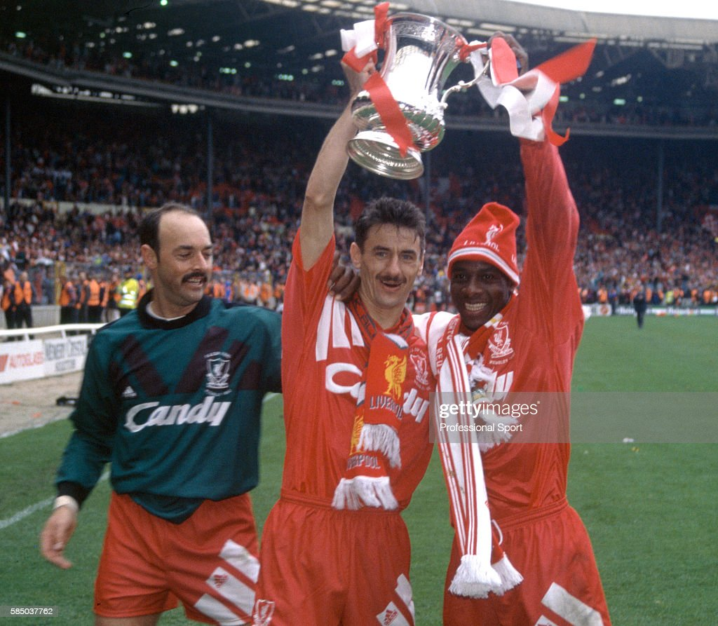 Liverpool goalscorers Ian Rush (centre) and Michael Thomas celebrate with Bruce Grobbelaar (left) and the trophy after Liverpool had beaten Sunderland 2-0 to win the 1992 FA Cup Final at Wembley Stadium on May 9, 1992 in London, England.