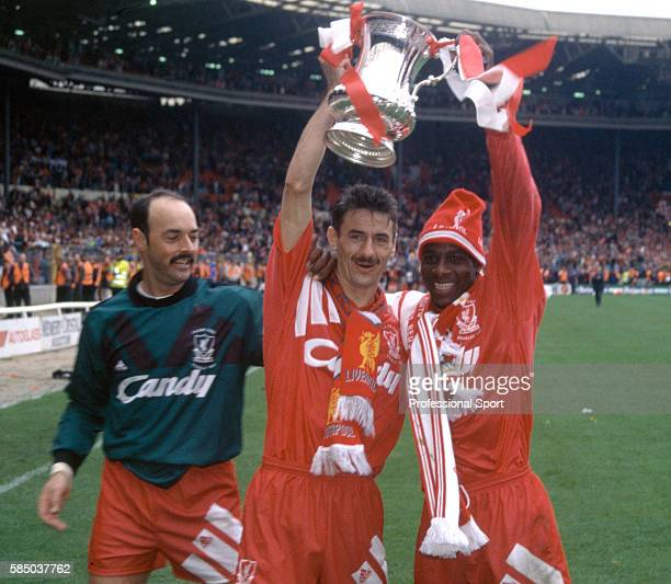 Liverpool goalscorers Ian Rush and Michael Thomas celebrate with Bruce Grobbelaar and the trophy after Liverpool had beaten Sunderland 20 to win the...