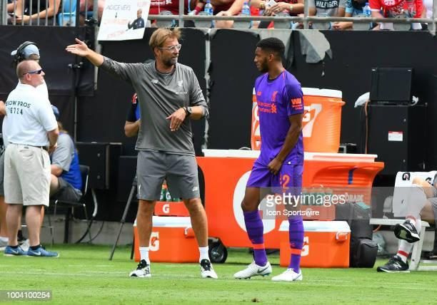 Liverpool Head Coach Jurgen Klopp talks to Liverpool defender Joe Gomez on the sideline during an International Champions Cup match between LiverPool...