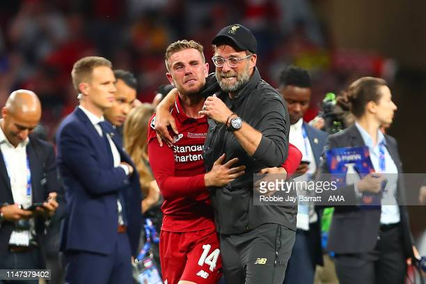 Liverpool Head Coach / Manager Jurgen Klopp celebrates with Jordan Henderson of Liverpool at the end of the UEFA Champions League Final between...