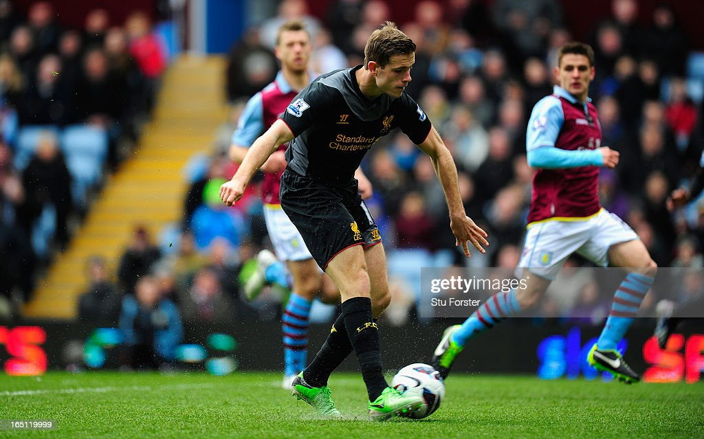 Liverpool Jordan Henderson scores the first Liverpool goal during the Barclays Premier League match between Aston Villa and Liverpool at Villa Park on March 31, 2013 in Birmingham, England.